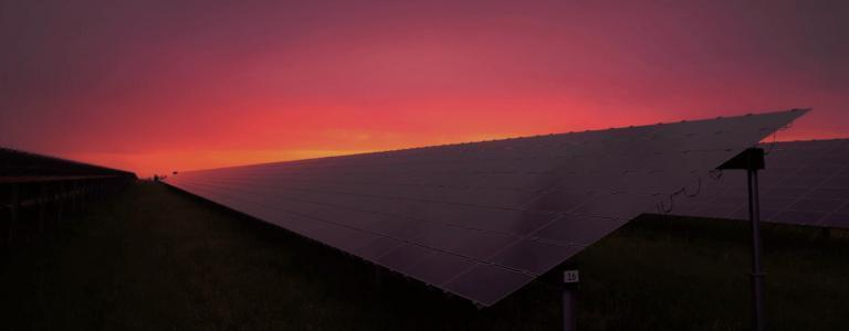 Line of solar panels at sun set